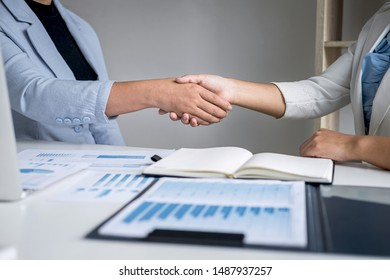 Finishing up a conversation after collaboration, handshake of two business woman leader after successful contract agreement to become a partner, collaborative negotiation partnership.