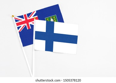 Finland and British Virgin Islands stick flags on white background. High quality fabric, miniature national flag. Peaceful global concept.White floor for copy space.