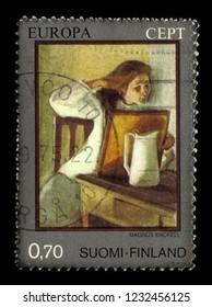 FINLAND - CIRCA 1975: stamp printed by Finland, shows girl straightening her hair, artwork by Magnus Enckell, finnish symbolist painter, circa 1975