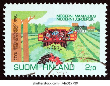 FINLAND - CIRCA 1992: A stamp printed in Finland issued for the centenary of National Board of Agriculture shows Currant Harvesting, circa 1992.