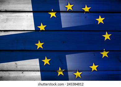 Finland and European Union Flag on wood background