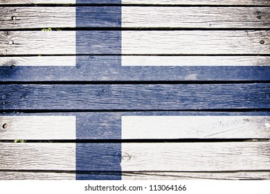 finland, finnish flag painted on old wood plank background