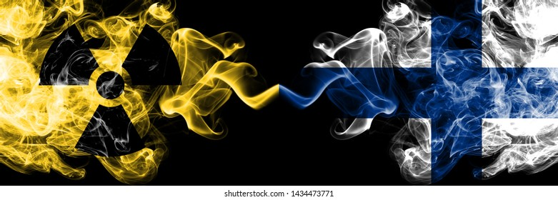Finland, FInnish vs nuclear smoky mystic flags placed side by side. Thick colored silky smokes combination of Finland, FInnish flag and radioactive sign.