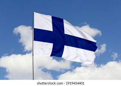 Finland flag isolated on the blue sky with clipping path. close up waving flag of Finland. flag symbols of Finland.