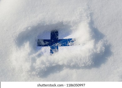 Finland flag in the snow. Flag in a snowdrift.