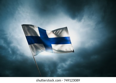 Finland flag waving with pride on a cloudy day.