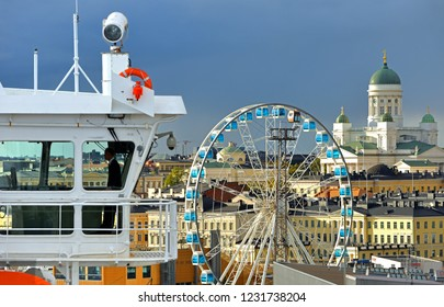 FINLAND, HELSINKI - SEPT 24, 2018: Finnair SkyWheel, Finnish Evangelical Lutheran cathedral of Diocese (1852) and bridge of MS Gabriella, Viking Line