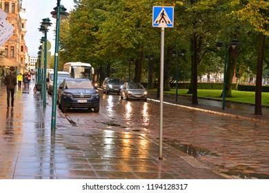 FINLAND, HELSINKI - SEPT 26, 2018: Autumn evening after rain. Street and Esplanadi, urban park