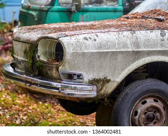 Finland, Koli National Park - 09/27/2018 Dump of rusting cars of the concern VAG. The threat of ecology in the national pair