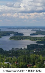 Finland landscape with lake, small islands and forest. Tower point of view. Bright summer day.