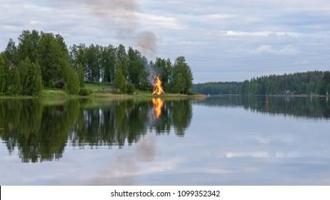 Finland. Midsummer feast, bonfire and lake