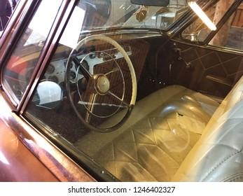 Finland, Savonlinna, 21 October 2018. vintage car Studebaker, interior view through glass, driver seat, steering wheel, dashboard, leather interior