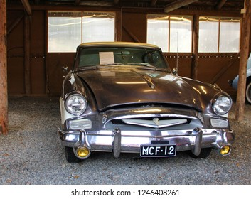 Finland, Savonlinna, 21 October 2018. vintage car Studebaker, car view, silver gray, excellent condition, located in a wooden hangar, garage, the era of the past