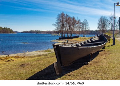 Finland. Savonlinna. Southern Savonia: Exhibit ancient boat on the lake at spring sunny day near the Lake Saimaa Nature and Museum Centre Riihisaari and Olavinlinna fortress - Olofsborg.
