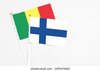 Finland and Senegal stick flags on white background. High quality fabric, miniature national flag. Peaceful global concept.White floor for copy space.