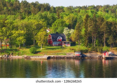 Finland, small red houses on an island in the Baltic Sea