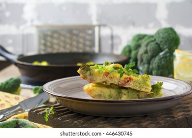 Finnis omelet with broccoli, fish, potatoes and onions. Rustic style. Selective focus.