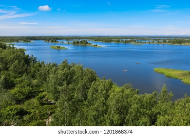 Finnish archipelago around Vaasa with green plants, trees and shallow blue water in summer