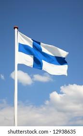 The Finnish flag against a blue sky