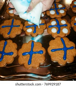 Finnish flag gingerbread cookies celebrating Finlands independence day 6th of december with blue and white icing onto brown biscuits