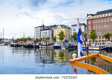 Finnish flag on the boat and summer view of North port Helsinki, Finland. Europe.