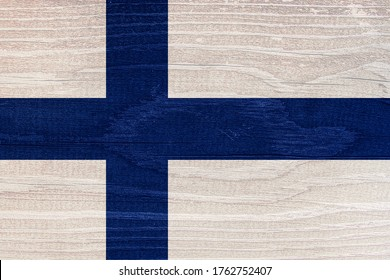 The Finnish flag with the texture of wood. Finnish flag on wooden texture