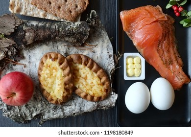 Finnish food with salmon, karelian pirogs(cake) and whole rye bread.