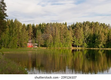 Finnish house on the shore of lake forest.