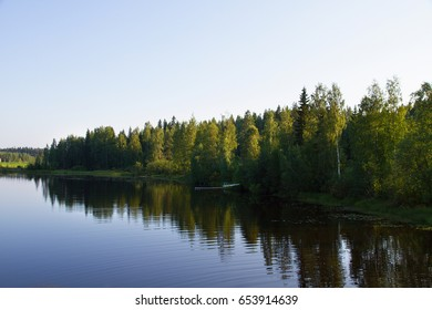 Finnish Lake with mirror in water in summer day.