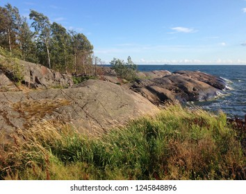 Finnish landscape on the shore to the Baltic Sea with trees and ocean coastline on Suomenlinna Island (former Viapori), a sea fortress or castle on six islands belonging to capital Helsinki, Finland