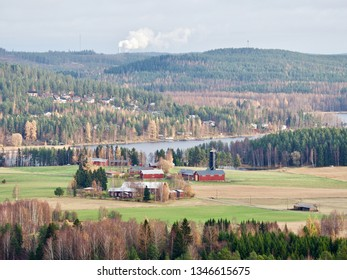 Finnish landscape with some buildings in the distance in autumn. Fall colors.