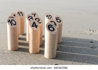 Finnish original outdoor fun game with wooden pins Mölkky on the beach