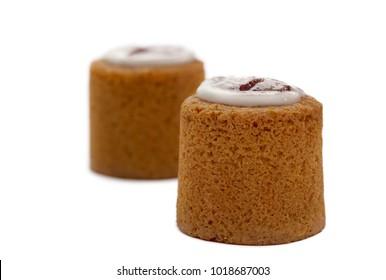 Finnish pastry, Runeberg cake, Runebergin torttu, baked with almonds, rum, raspberry jam and sugar icing. Two Runeberg cakes isolated on white background.