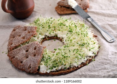 Finnish sandwich with cream cheese, cress, and round bread Reikaleipa