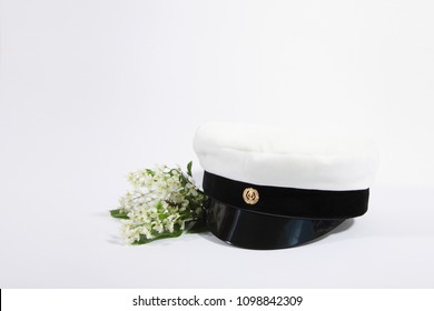 finnish student cap, ylioppilaslakki with white background and bird cherry branch
