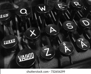 "Finnish vintage typewriter including uppercase ""Vaihto"" (Shift), ""Lukko"" (Caps Lock), letter Å with ring, letter Ä with diaeresis, and QWERTY keys."