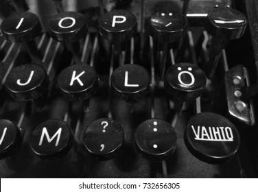"Finnish vintage typewriter including uppercase ""Vaihto"" (Shift), letter O with diaeresis, combining diaeresis, and arrow keys."