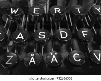 Finnish vintage typewriter including uppercase letter Å with ring, letter Ä with diaeresis, QWERTY, and ASDF keys.