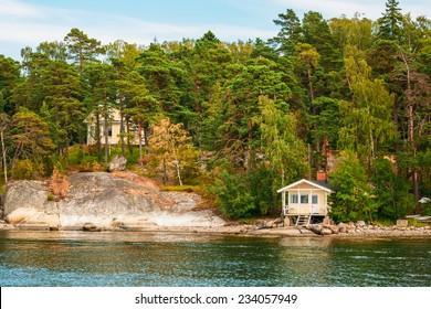 Finnish Wooden Sauna Log Cabin On Island In Summer