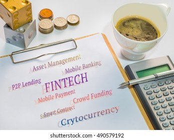 Fintech concept. Fintech application messages on sheet with clipboard, cup of coffee,, Calculator, pen, coins and dices.