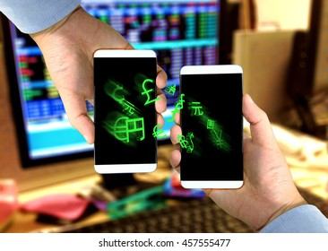 Fintech concept image. Two smart phones exchange world currencies sign on screen against coded stock exchange computer background. Representing Transfer money by coded money or digital money.