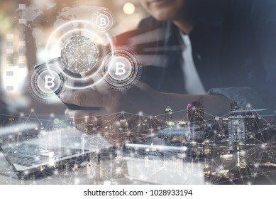 Fintech, Financial technology, Blockchain technology concept, Businessman holding smartphone and virtual system diagram bitcoin wallet cryptocurrency, smart city and network background