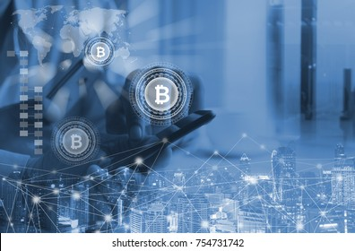 Fintech, Financial technology, Blockchain technology concept, Businessman holding smartphone and virtual system diagram bitcoin wallet cryptocurrency, smart city and network background, blue tone.
