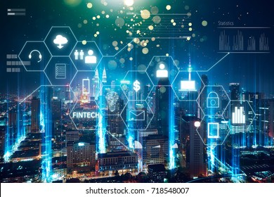 """Fintech"" word on digital virtual screen with futuristic city skyline. Hi-tech business concept ."