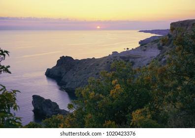 Fiolent, Sevastopol, Crimea, Russia. Sunset time over Black sea. Yellow, purple, lilac colors.