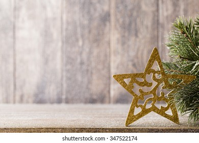 Fir branch and decor, on the wooden background.