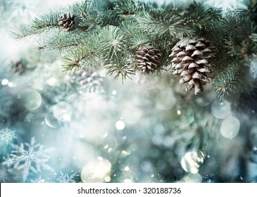 Fir Branch With Pine Cone And Snow Flakes - Christmas Holidays Background