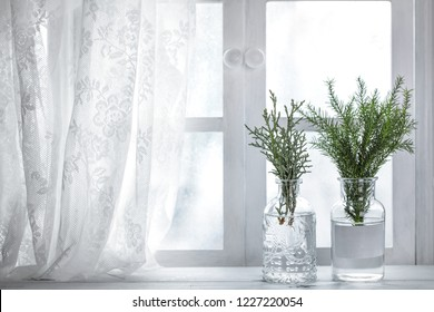 Fir branch in vase near window.Christmas decoration