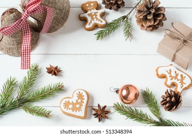 Fir branches, Christmas cookies and fir cones