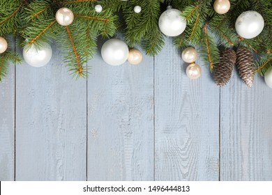 Fir branches with Christmas decoration on grey wooden background, flat lay. Space for text